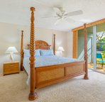 The bedroom opens up to a front lanai.