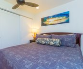 Comfortable King Sized Bed with ceiling fan.