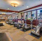 Fully Equipped Fitness Center with Locker Room, Dry Sauna, and Steam Room