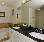 Master Bathroom with Dual Sinks, a Large Soaking Tub and Separate Walk-in Shower