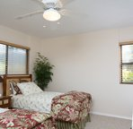 Guest room equipped with two twin beds.
