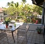 The Rear Lanai overlooks the landscaped grounds and the swimming pool.