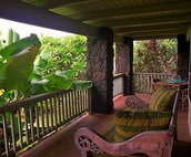 A wonderful wrap around lanai provides outdoor dining.  A soothing hot tub spa awaits just off the lanai in the yard.  Follow the lanai to the steps leading to the upper deck where you can enjoy a private meal, sunbathing, or whale watching.