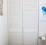 Closet with some beach toys and plenty of space to hang your stuff.