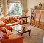 Living room is equipped with flat screen TV, high speed wireless, CD player, and writing desk