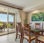Elegant dining set detail with view to lanai.