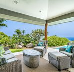 Pool Side Relaxation with Coastline Views