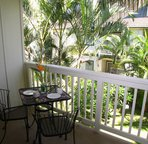 The lanai off the master bedroom has a comfortable, private, sitting area overlooking the garden landscaping of the Poipu Kai grounds.